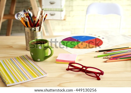 office desk and a cup of coffee - stock photo