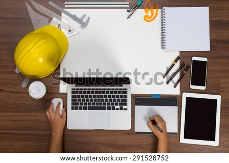 Office desk background hand using mouse pen construction project ideas concept, With laptop computer, drawing equipment and cup of coffee. View from above with copy space - stock photo