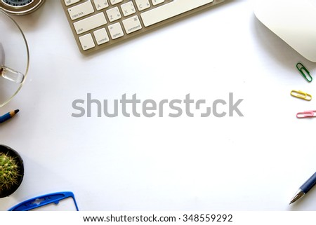 Office desk background with keyboard and cup of coffee. View from above. - stock photo