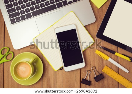 Office desk mock up template with laptop and smart phone. View from above - stock photo