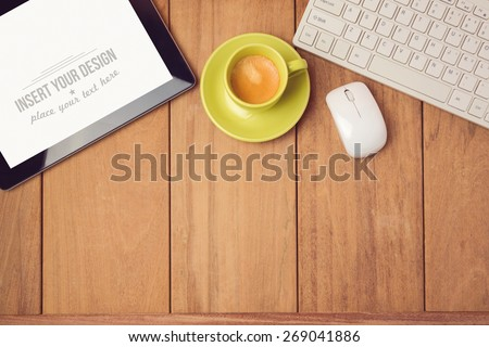 Office desk mock up template with tablet, keyboard and coffee cup. View from above - stock photo