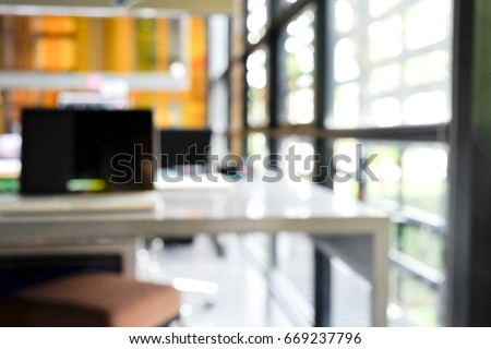 Office desk, out of focus image of modern office interior background. An idea of modern workspace and coworking space, modern lifestyle,Gig Economy