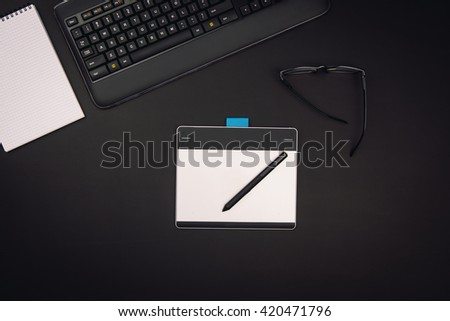 Office desk seen from above. Product photograph taken from above, top view, with copy space for concepts or type. - stock photo
