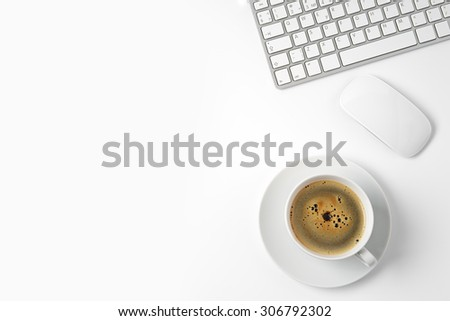 office desk table with computer and coffee cup - stock photo
