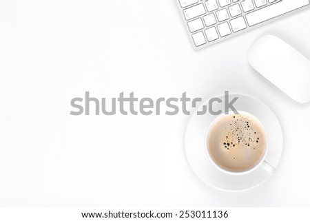 Office desk table with computer and coffee cup. Top view with copy space - stock photo