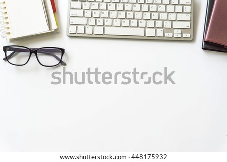 Office Desk Table With Computer Keyboard, Office Supplies On White  Background Top View / Image