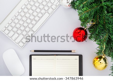 office desk table with computer supplies and christmas tree top view with copy space christmas tree office desk