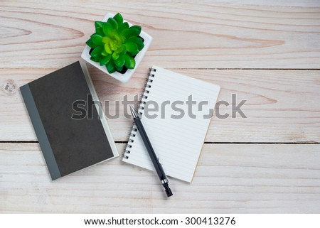 Office desk table with note paper and flower. Top view with copy space - stock photo