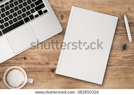 office desk top view with blank notebook - stock photo