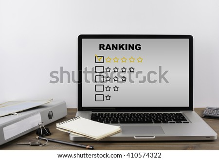 Office desk with a laptop. Excellent Ranking - stock photo