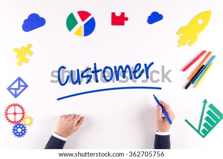 Office desk with a single word Customer - stock photo