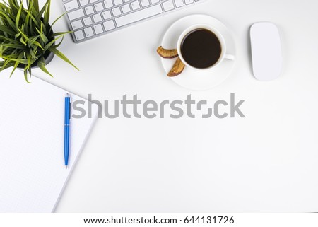 Office desk with copy space. Digital devices wireless keyboard and mouse on office table with notepad and cup of coffee, top view