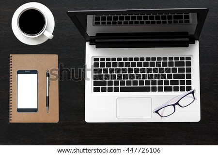 Office desk wood table of Business workplace, notebook Laptop and mobile coffee cup, Top view with copy space.
