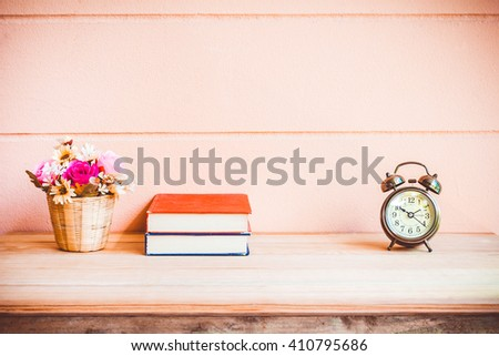 Office desk workplace with books and alarm clock on the wooden table. - stock photo