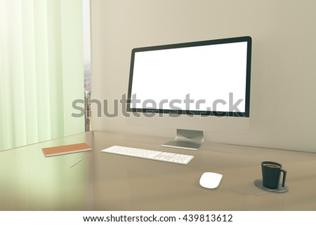 Office desktop with blank white computer monitor, coffee cup, keyboard, mouse and notepad next to window with blinds and city view. Mock up, 3D Rendering