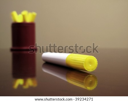 Office desktop with yellow highlighter pens - stock photo