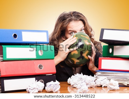 Office fight concept with female worker - stock photo