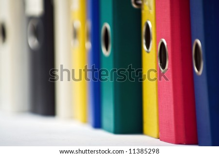 Office folders at the bookshelf - stock photo