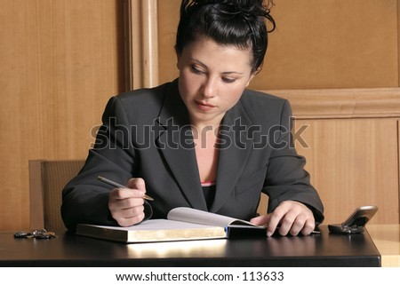 Office hours - busy woman in office
