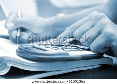 Office image with blue tones, useful for brochures and coupons - stock photo