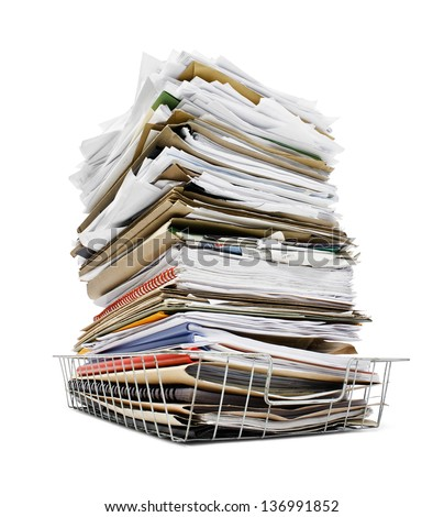 office in tray piled high with a large amount of overwhelming work good concept for stress - stock photo