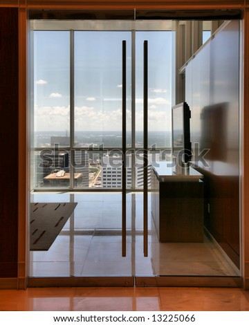 Office Interior with Flatscreen TV overlooking skyline in Houston, Texas (Release Information: Editorial Use Only. Use of this image in advertising or for promotional purposes is prohibited.)