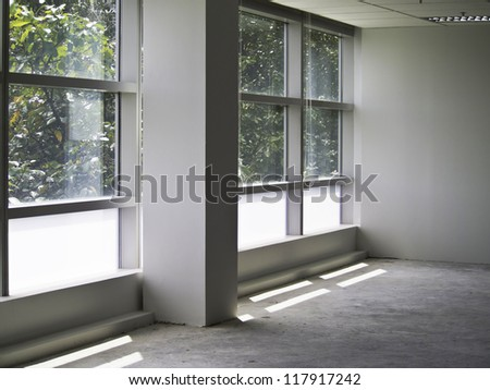 Office interior with glass wall and nature