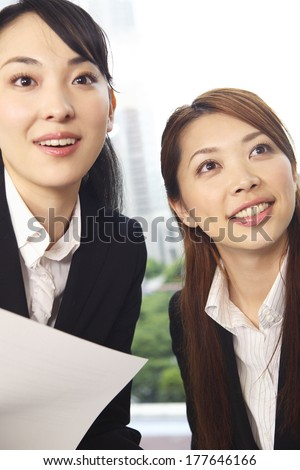 Office Japanese Ladies in the meeting while watching the material - stock photo
