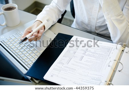 Office lady working and flipping pen