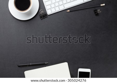 Office leather desk table with computer, supplies and coffee cup. Top view with copy space - stock photo