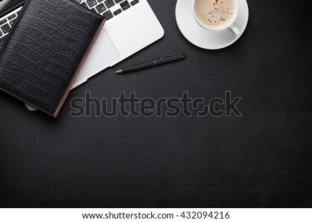 Office leather desk workplace table with laptop, coffee cup, notepad and pen. Top view with copy space - stock photo