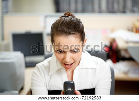 Office life. Beautiful woman talking over phone. - stock photo