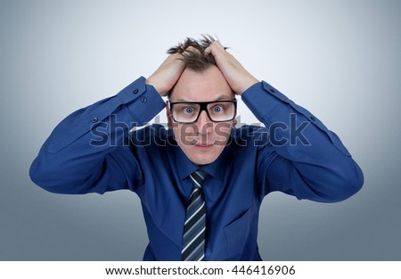 Office man in glasses grabbed his head. Deep fear of businessman - stock photo