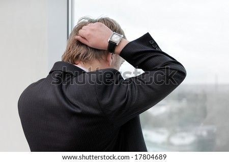 office manager looking thorough window - stock photo