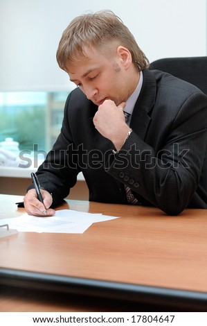 office manager signing the document - stock photo