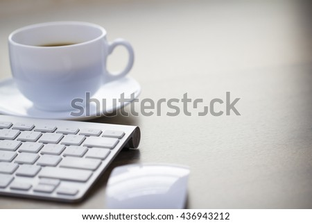 Office morning coffee and modern keyboard background with right space