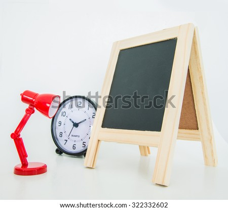 Office objects on white background, Alarm clock, Desk lamp, Wood chalkboard - stock photo