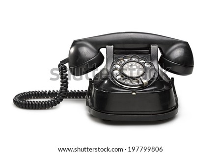 Office: old and vintage telephone Black on white background - stock photo