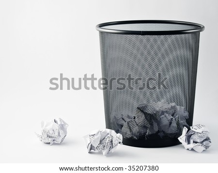 Office paper bin, trash, mess - stock photo