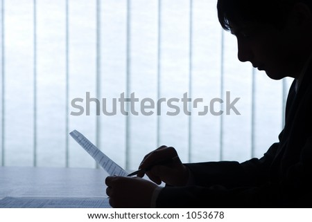 Office picture, man with pen and contract. Nice backlight and feeling, image is very clean, as always. - stock photo
