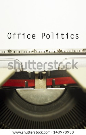 office politics, message on typewriter for conceptual background.