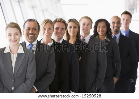 Office staff lined up looking to camera - stock photo