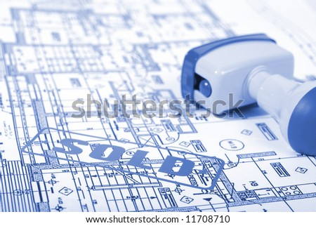 Office stamp over home plan in blue - stock photo