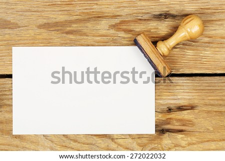 office stamp with blank piece of paper on wooden planks - stock photo