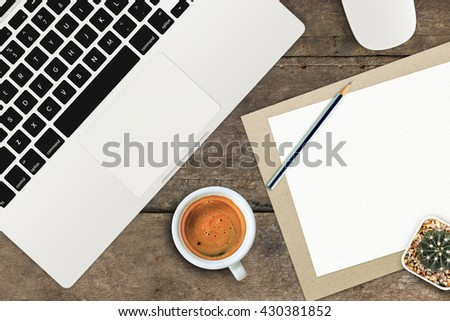 office supplies and gadgets on old wooden table background [view from above] - stock photo