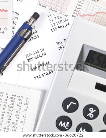 Office supplies, including calculator, pen and papers.