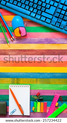 Office supplies, keyboard, computer mouse on wooden table, top view - stock photo