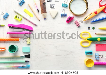 Office supplies on light wooden background - stock photo