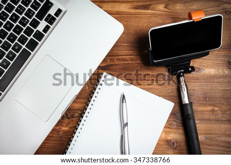 Office supplies on the wooden table - stock photo