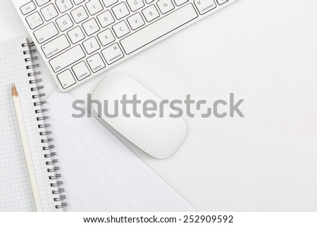 office supply and keyboard isolated on white - stock photo